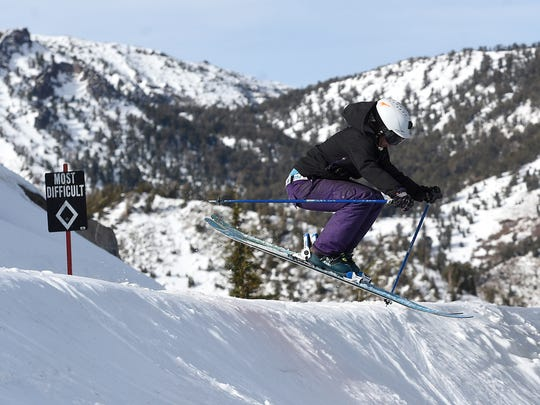 Jenn Sheridan, COO of Coalition Snow, catches some air using a pair of Coalition skis at Mt. Rose Ski Tahoe on Dec. 8, 2015.