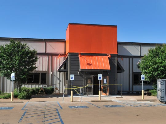 Construction work continues as workers renovate the old Logan's Roadhouse located on Call Field Road into a Hooters restaurant.