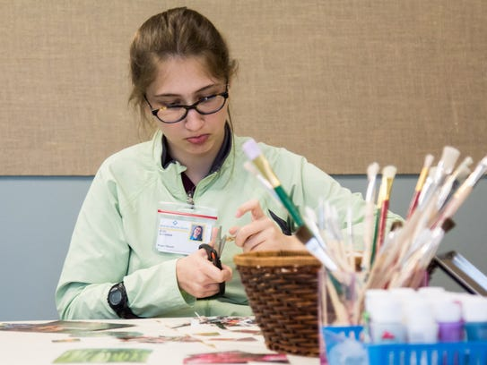 Project SEARCH student Eve Snedeker is assisting in