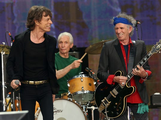 Mick Jagger (left) and Keith Richards (right) enjoy a laugh while drummer Charlie Watts keeps things nailed down during the Rolling Stones' two-night stint at London's Hyde Park this past summer.