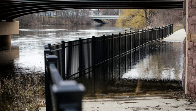 Flooding below the Saginaw Street bridge on April 3, 2017 after heavy rain showers. Officials say a new flood plain elevation study could decrease flood insurance rates locally.