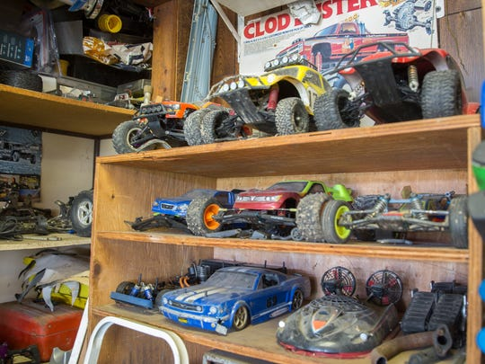 """Over 50 RC cars line the garage of Dan Bartles, known as """"Nitro Dan"""". Bartles runs a repair shop and racetrack outside of his home for RC enthusiasts."""