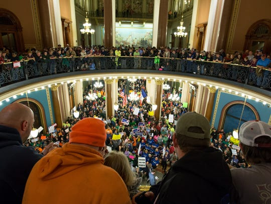 Demonstrators fill the rotunda Monday, Feb. 13, 2017,