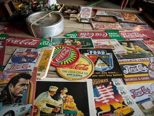 Collectible soda advertising signs in the collection