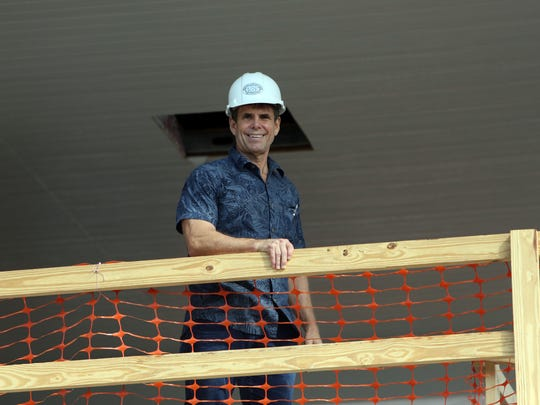 John McHugh poses for a portrait at the Island Plaza construction site.