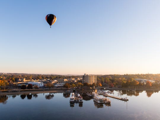 People can take hot air balloon rides over Lake Geneva