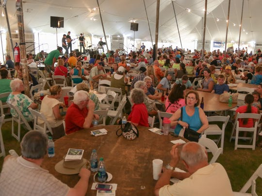 Members of G. Pat Harris band perform at the 45th annual Rockport Art Fest on Saturday, July 5, 2014.  The air conditioned tent provide a brief respite from the South Texas summer sun.