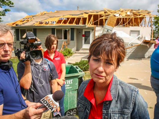 Iowa Gov. Kim Reynolds tours cleanup in Bondurant, Iowa, Friday, July 20, 2018, after a tornado slashed through the town Thursday afternoon.