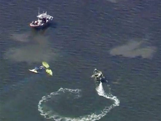 In this image provided by WTVT-TV FOX 13 Tampa Bay, authorities investigate a small plane crash in the Gulf of Mexico, near Holiday, Fla. on Tuesday, Nov. 7, 2017. Authorities have confirmed that former Major League Baseball pitcher Roy Halladay died in a small plane crash in the Gulf of Mexico off the coast of Florida.