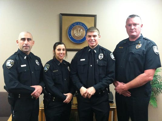 Officers Michael Iman, Heather Ivey, Matthew Jeter and Chief Shane McWilliam.JPG