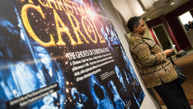 Air Force veteran Kim Gray of Rochester waits in the Geva lobby before Act 1 of A Christmas Carol.