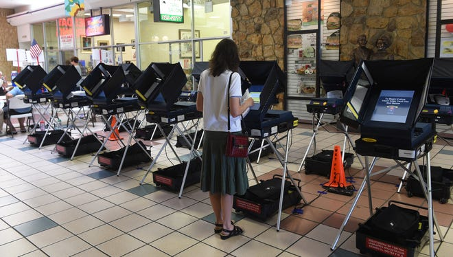 Voter Kelley Mooneyham cast her ballot during Nevada's Primary Election at Shoppers Square on June 14, 2016.