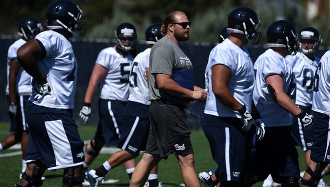 Wolf Pack graduate assistant Jeff Nady, middle, is helping mentor Nevada's offensive line.