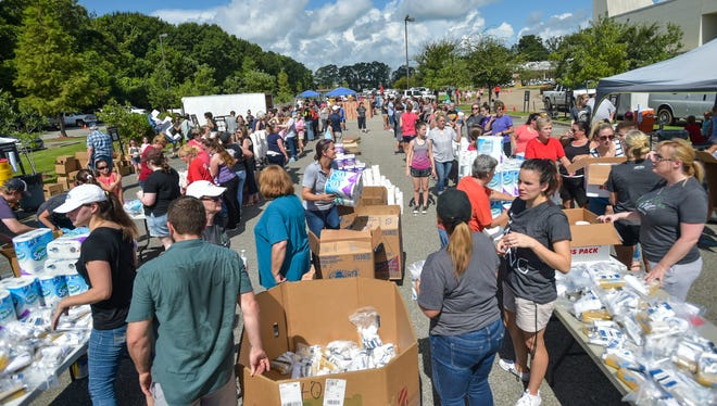 Volunteers at Crossroads Church working to distribute supplies to flood victims in Lafayette area. August 19, 2016.