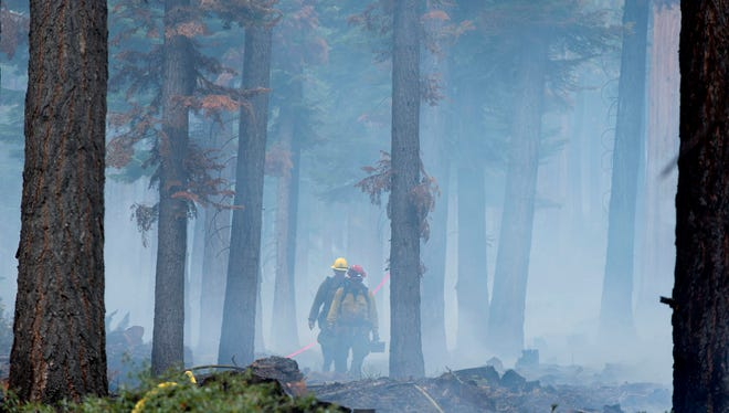 Fire crews work on the Emerald Fire along Highway 89, Friday, Oct. 14, 2016 near Lake Tahoe.