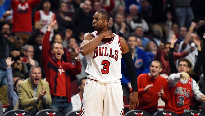Dwyane Wade celebrates after hitting a three-point shot late in the fourth quarter of his Bulls debut.