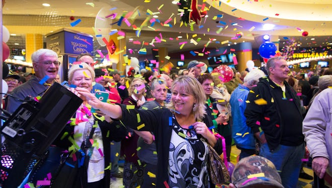 Confetti falls onto visitors as after Tioga Downs officially opened their new gaming floor and poker room on Dec. 2, 2016.