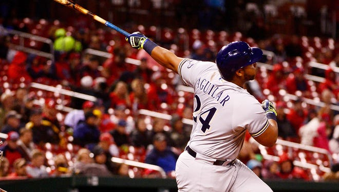 Jesus Aguilar of the Brewers hits a game-winning solo home run during the seventh inning.
