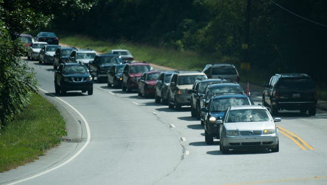 Traffic starts to build up on Hood Road as Powdersville Elementary, Middle and High Schools begin to let out in the afternoon on Friday, Sept. 15, 2017. The Anderson School District 1 wants to build a new road behind the middle school that will connect to Roe Road to help alleviate before and after school traffic.