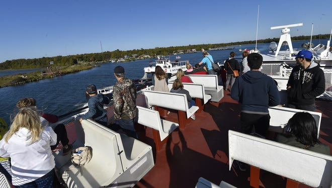 An oncoming ferry traverses on the portside as it heads to Northport while passengers approach Washington Island on Sunday morning, Oct. 8, 2017.