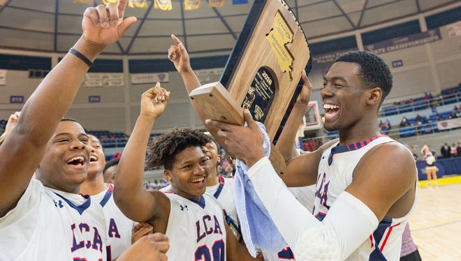 Lafayette Christian Academy players celebrate their win over St. Mary's for the Division IV state basketball championship Friday March 9, 2018.