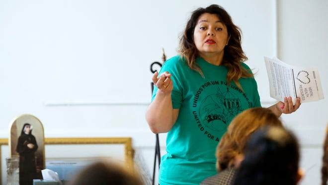 Norys Pina, a volunteer leader of Unidos Por Un Futuro Mejor (United for a Better Future), speaks about DACA on Sept. 17, 2017, at St. Therese Parish in Appleton.