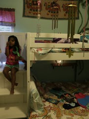 Inspired by her recent trip to Memphis to attend the off-Broadway production of The Little Mermaid, Cora Baisden, 6, gives her best mermaid pose at her home outside Jackson, Mississippi.