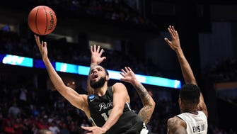 Nevada forward Caleb Martin shoots against Cincinnati during the the second round of the 2018 NCAA tournament at Bridgestone Arena.