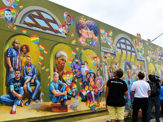 A working concept mural by volunteers with Inspiration Orlando. June 12, 2017 marks the one-year anniversary of the Pulse nightclub massacre that took 49 lives and wounded over 50 others. A packed public event was held from 11:00am-1:00pm at the site of the killings.