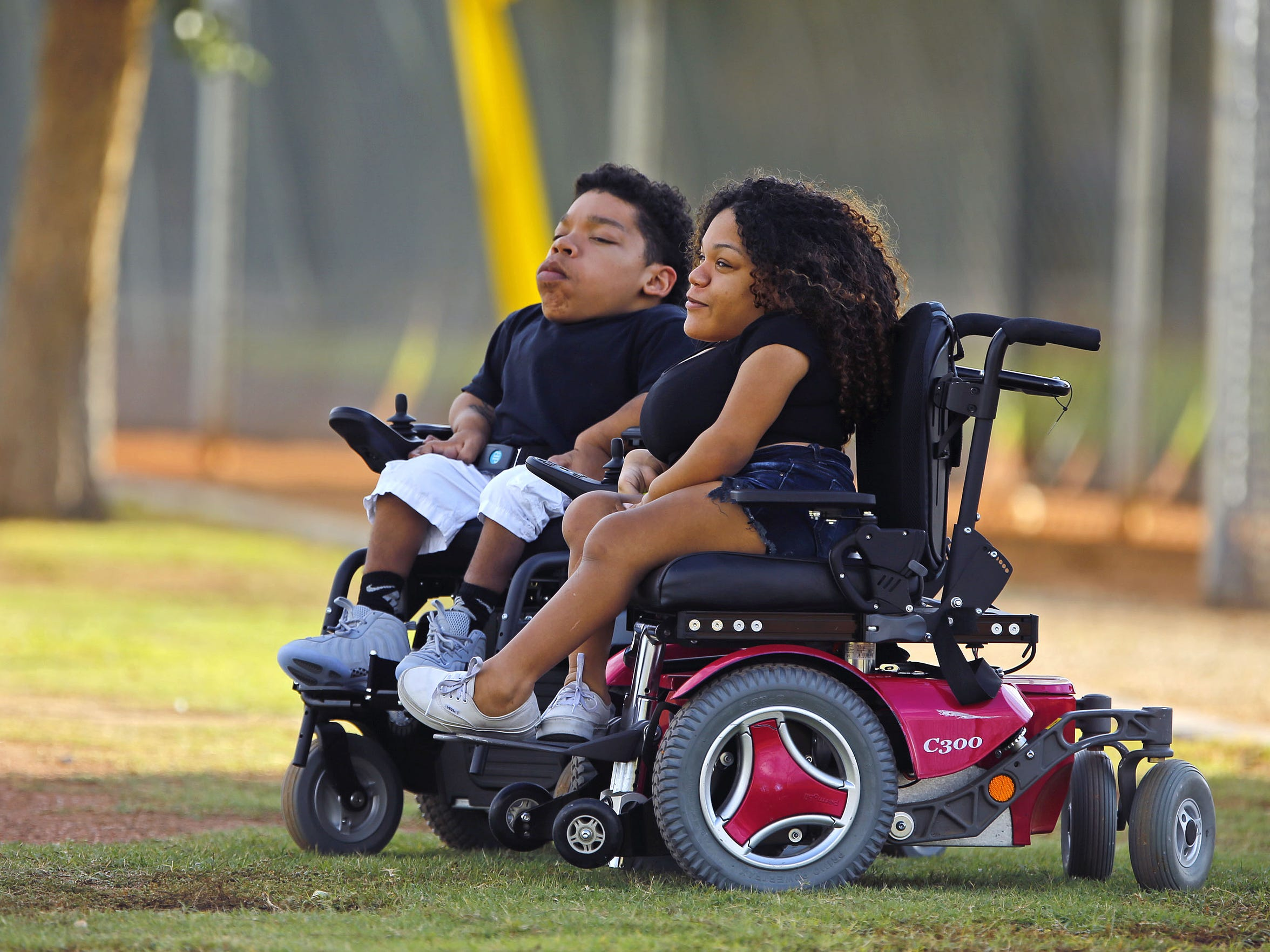 Justin and Kianna White watch their cousin, Saguaro High football player Byron Murphy, during practice on Wednesday, Oct. 21, 2015 in Scottsdale, Ariz.