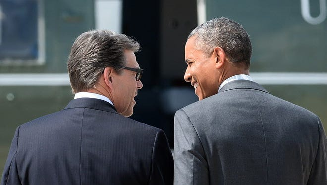 Texas Gov. Rick Perry welcomes President Obama to Dallas on Wednesday.