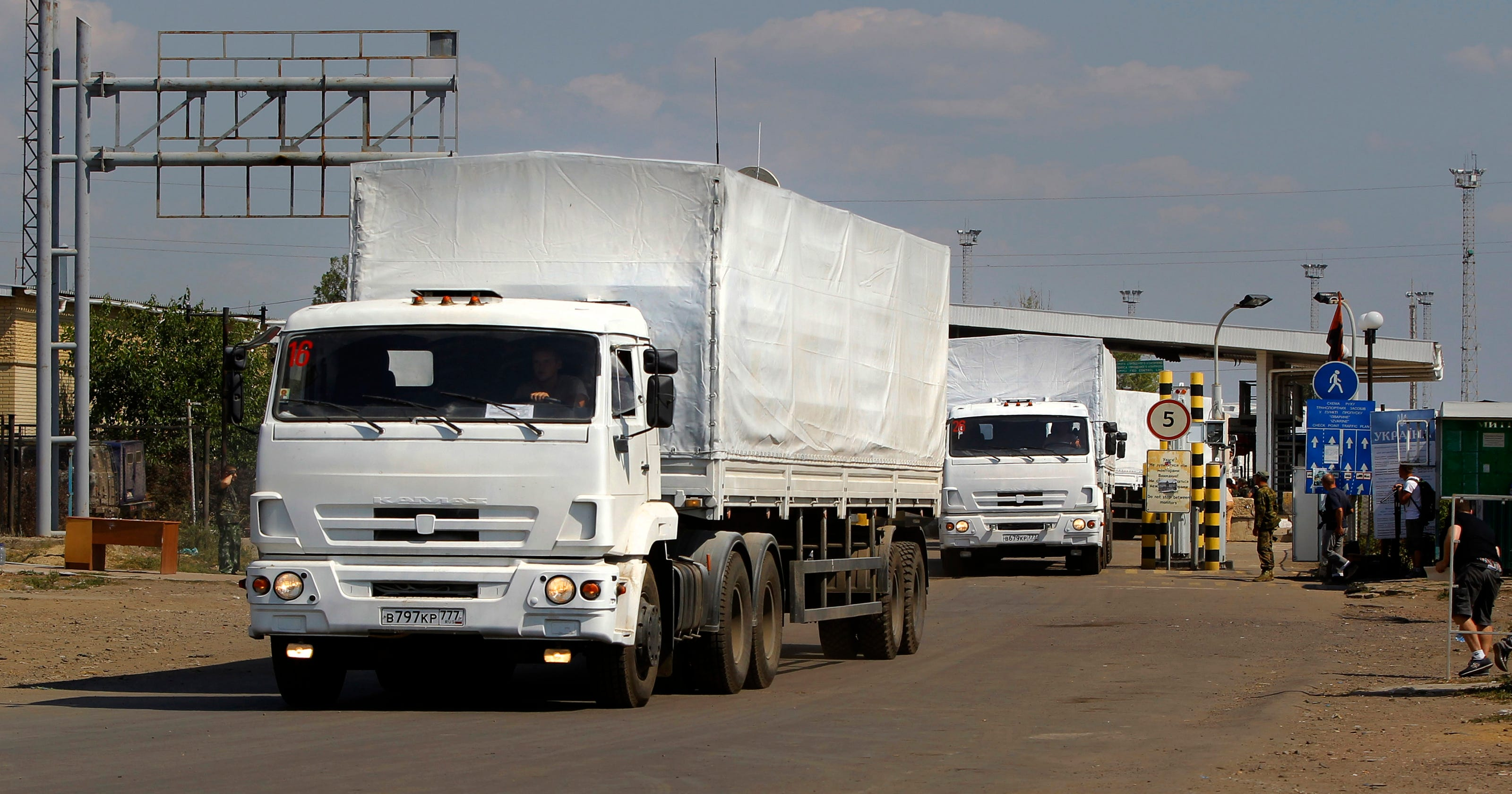 Russian Convoy Arrives In Ukraine Amid Shelling Reports Moreover Car Hauler Trailer Plans Utility Wiring