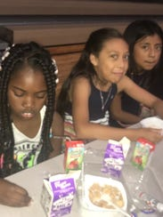 Children at Freedom Preparatory Academy after a breakfast