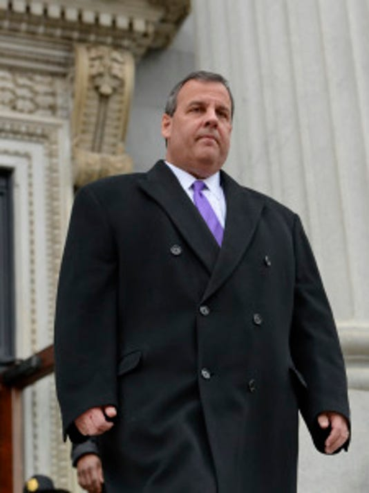 Gov. Chris Christie walks down the steps of the South Carolina Capitol before the inauguration ceremony for Gov. Nikki Haley, Wednesday, Jan. 14, 2015, in Columbia, S.C.   (AP Photo/Richard Shiro)