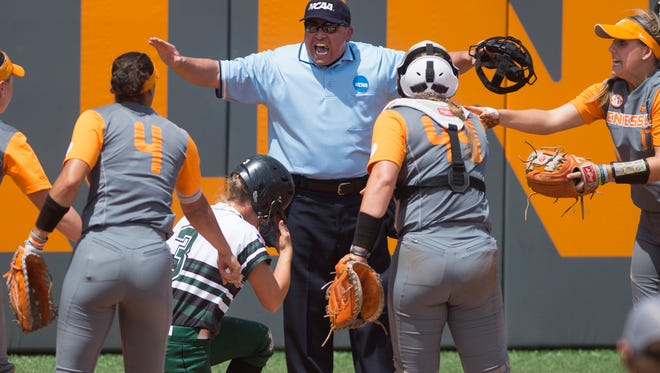 Chaos ensues at home plate as an umpire calls USC Upstate's Ansley Gilstrap (3) safe after Tennessee's Abby Lockman (44) attempted to tag her out at home during an NCAA Regional game between Tennessee and USC Upstate at Sherri Parker Lee Stadium on Saturday, May 20, 2017.