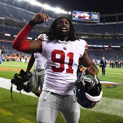 Giants rookie defensive end Avery Moss celebrates Sunday's