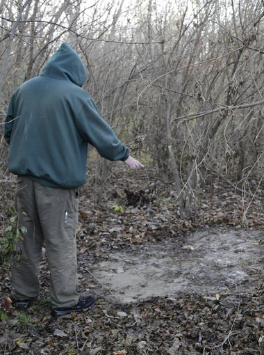 A local homeless who wants to remain anonymous points Wednesday, Nov. 11, 2015, to the patch in the ground where his tent once lay. A trail manager worked with  West Lafayette police to remove the tent. The man was not given notice -- a policy that had been put in place in Lafayette.