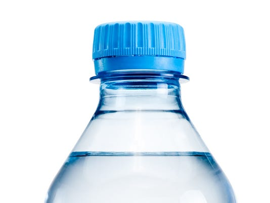 Plastic water bottle with no label on white background