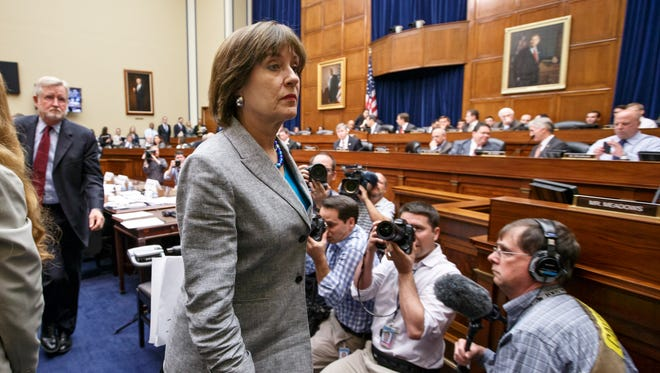 IRS official Lois Lerner leaves a House hearing last year.