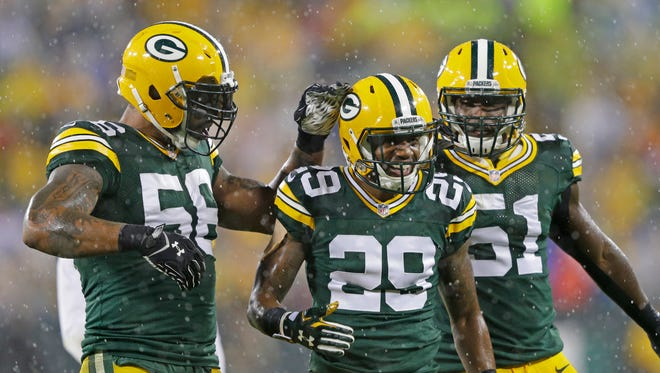 Green Bay Packers cornerback Casey Hayward (29) celebrates with outside linebacker Julius Peppers (56) and inside linebacker Nate Palmer (51) against the Kansas City Chiefs at Lambeau Field September 28, 2015.