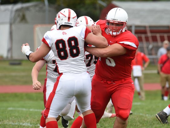 Red Hook's Liam Dietrich, right, pushes through the