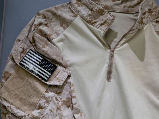 The fatigue shirt worn by Navy SEAL Robert O'Neill during the mission to capture Osama bin Laden is displayed  in a case at the National September 11 Memorial and Museum.