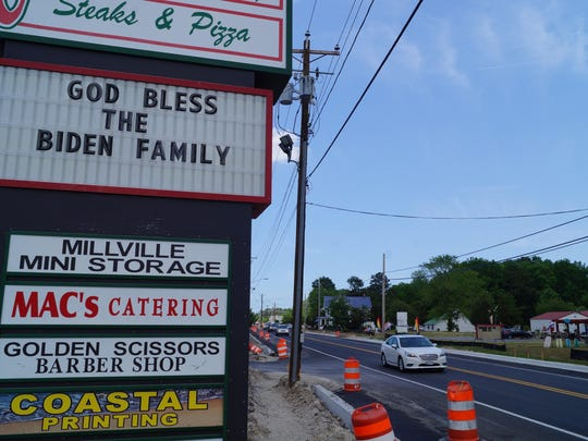 A sign outside the Shoppes at Millville expresses sympathy for the Bidens on Sunday.