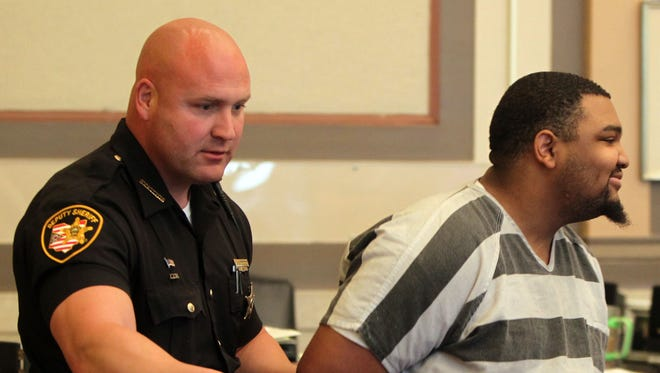 Craig McIntosh, 19, smiles as he enters Hamilton County Common Pleas court to be sentenced for two killings.