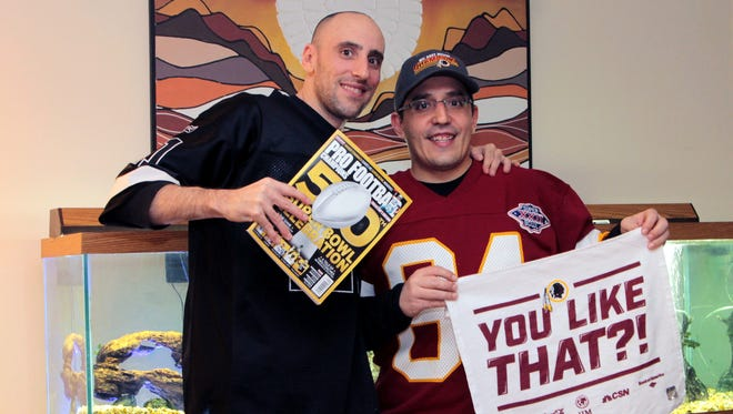"Nathan Adamus, left, and his brother Neil Adamus pose with the ""Pro Football Champions"" magazine. Both are Washington Redskins fans."