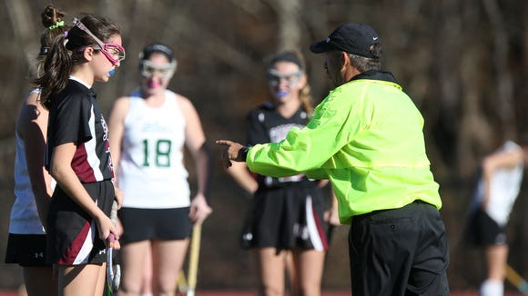 An Offical (right) gives a warning to Scarsdale's Elizabeth