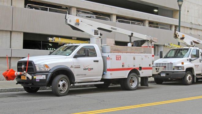 Verizon vehicles are parked near the Centertown parking garage on West Gray Street in Elmira.