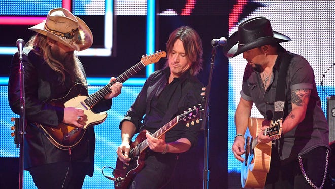 2017 CMT Artists of the Year Chris Stapleton, Keith Urban and Jason Aldean perform 'I Won't Back Down' during the show at Schermerhorn Symphony Center Wednesday, Oct. 18, 2017 in Nashville, Tenn.