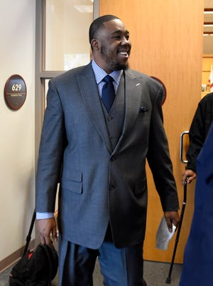 Detroit Lions defensive tackle Nick Fairley smiles as he walks out of circuit court.