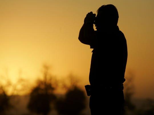 A Border Patrol agent monitors the U.S.-Mexico border